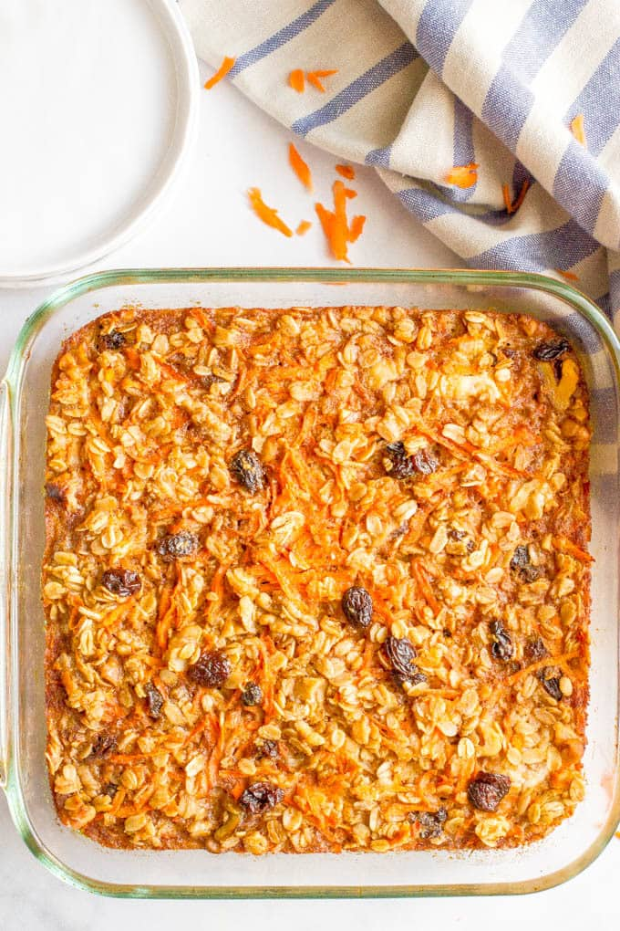Carrot cake baked oatmeal is naturally sweetened and loaded with walnuts and raisins for a healthy make-ahead breakfast! | www.familyfoodonthetable.com