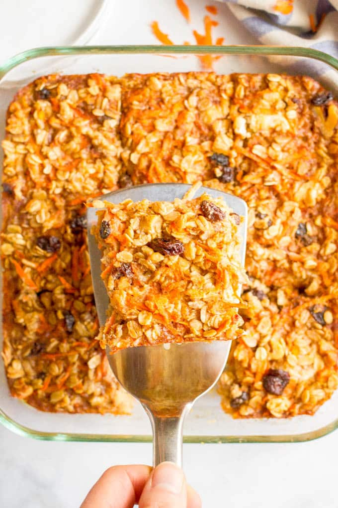 Carrot cake baked oatmeal is naturally sweetened and loaded with walnuts and raisins for a healthy make-ahead breakfast! #carrotcake #oatmeal #bakedoatmeal #breakfastrecipes