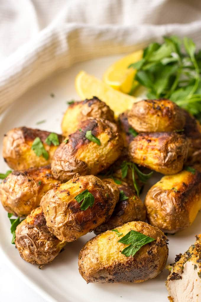roasted new potatoes, served with an herb-crusted roasted pork ...