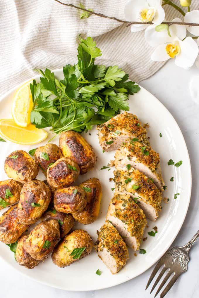Herb roasted pork tenderloin with potatoes is an easy but elegant sheet pan dinner with tons of flavor! | www.familyfoodonthetable.com