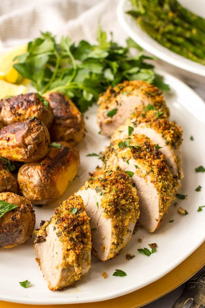 Herb roasted pork tenderloin with potatoes is an easy but elegant sheet pan dinner with tons of flavor! Great for company or a special occasion!