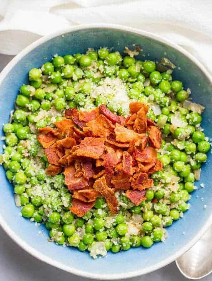 Peas with bacon, shallots and Parmesan cheese is a quick and easy side dish and super flavorful way to dress up a bag of frozen peas!   www.familyfoodonthetable.com