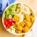 Turmeric chicken bowls with rice and hummus