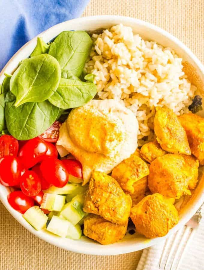 Turmeric chicken bowls with basmati rice, veggies and hummus are a quick, easy and super flavorful dinner!