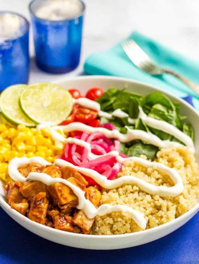 BBQ chicken quinoa salad bowls are full of flavor and fresh veggies and make for a really easy, healthy dinner! Also great as a make-ahead lunch or picnic!   www.familyfoodonthetable.com