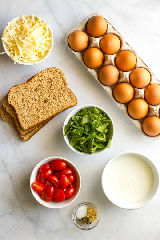 Ingredients laid out to make individual egg breakfast casseroles