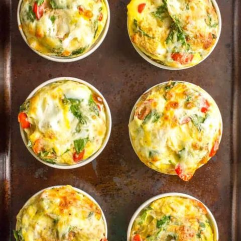 Individual breakfast casseroles with eggs, bread, veggies and cheese are made in ramekins and can be customized to suit everyone's tastes - great for a crowd! | www.familyfoodonthetable.com