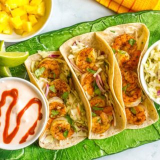 Shrimp tacos with lime cabbage slaw and spicy yogurt sauce