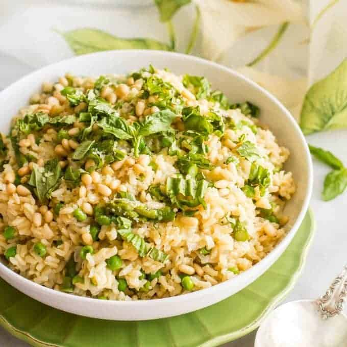 One-pot spring rice pilaf with asparagus and peas is a bright, fresh and easy side dish that's topped with Parmesan cheese, fresh basil and (optional) pine nuts!   www.familyfoodonthetable.com