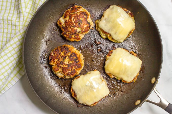 Zucchini turkey burgers cooked in a pan