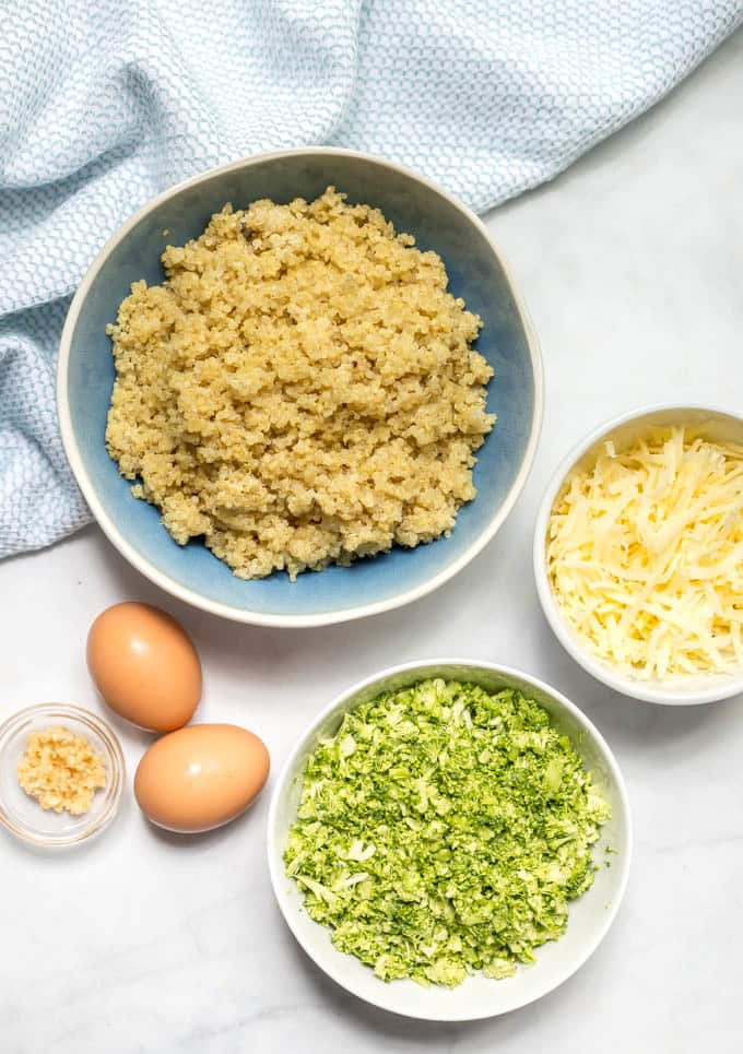 Broccoli cheese quinoa bites ingredients arranged in separate bowls