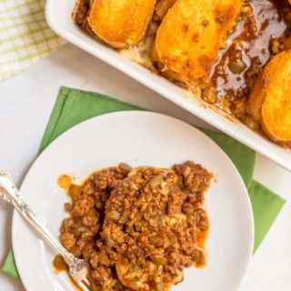 Cheesy sloppy Joe casserole is an easy family dinner with saucy sloppy Joe's, plenty of melted cheese and crusty bread on top - perfect for a weeknight dinner! | www.familyfoodonthetable.com