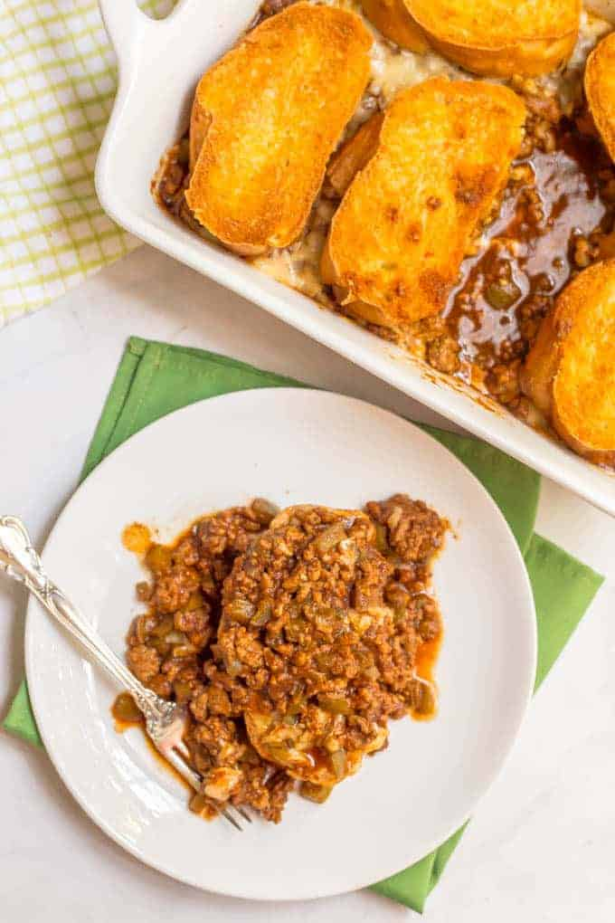 Cheesy sloppy Joe casserole is an easy family dinner with saucy sloppy Joe's, plenty of melted cheese and crusty bread on top - perfect for a weeknight dinner!