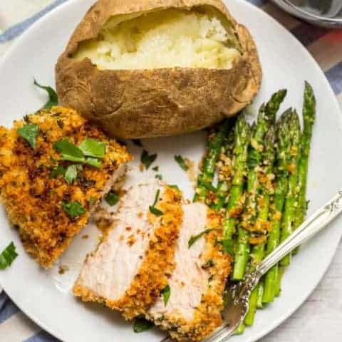 Crunchy baked pork chops are coated in a breadcrumb and Parmesan mixture then put in the oven for an easy, hands-off dinner that's sure to be a family favorite! | www.familyfoodonthetable.com