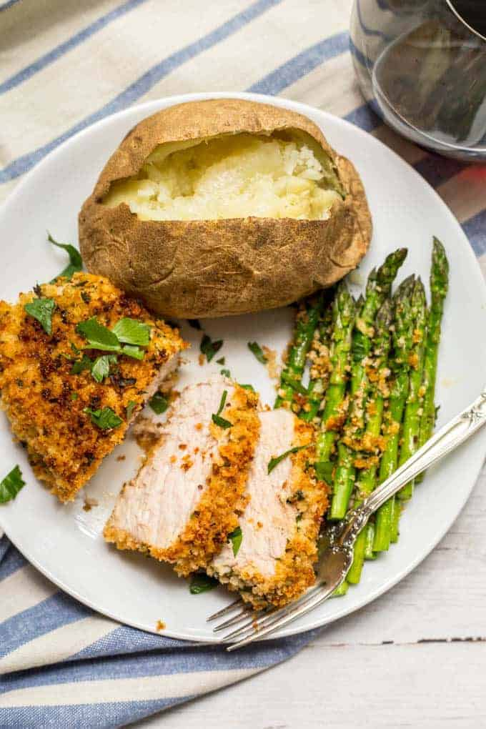Crunchy baked pork chops are coated in a breadcrumb and Parmesan mixture then put in the oven for an easy, hands-off dinner that's sure to be a family favorite! #porkchops #pork #dinner #easyrecipe #lowcarb #glutenfree