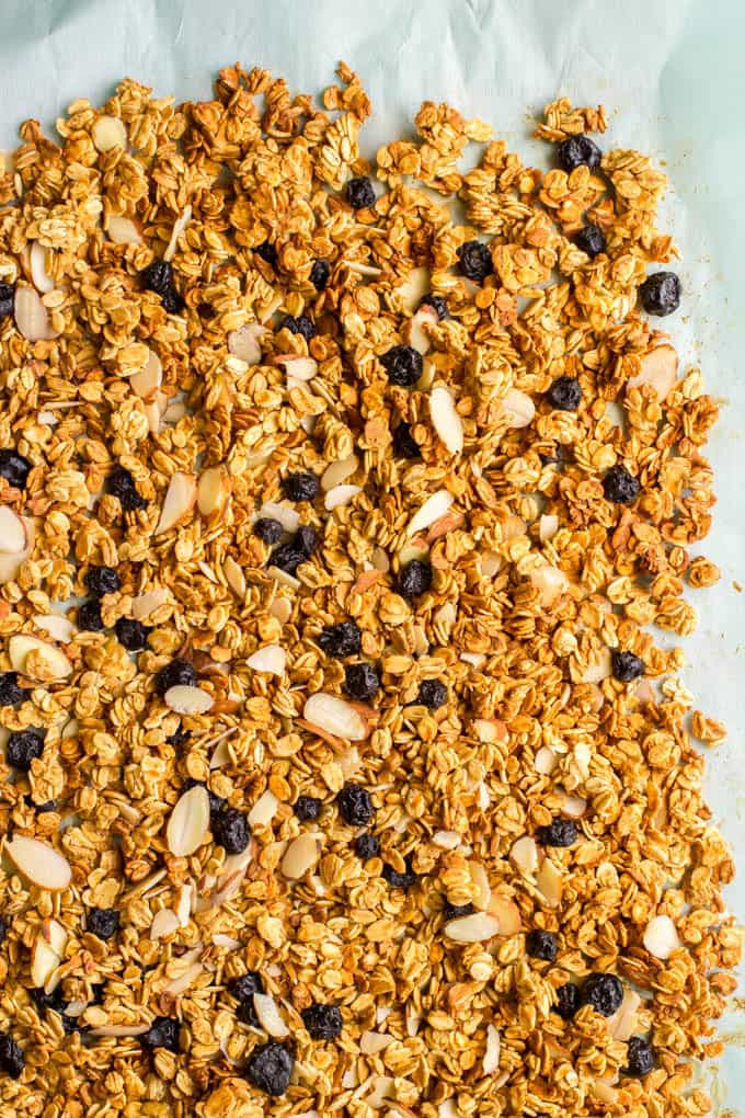 Crunchy granola on a piece of parchment paper after baking