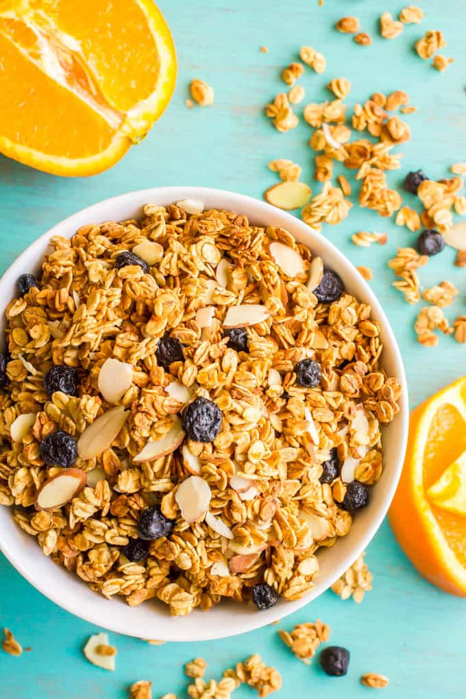 Healthy citrus granola is lightened up and full of orange flavor for a fresh, fruity granola that's great for breakfast or snacking! #granola #breakfast #healthysnacks