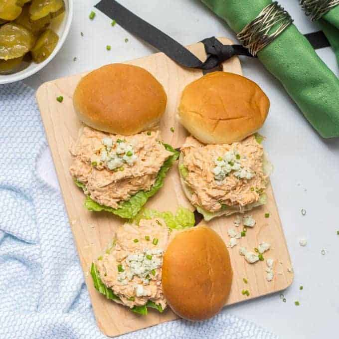 Healthy slow cooker buffalo chicken sliders being served