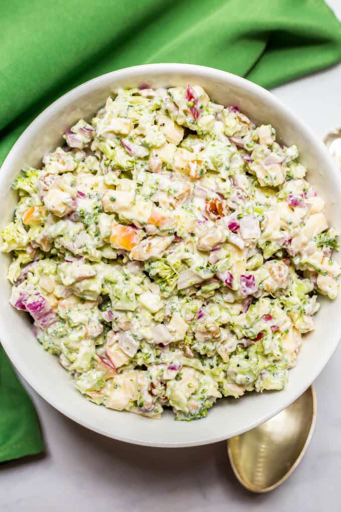 Healthy broccoli apple salad is mixed with walnuts, raisins and a cool, creamy sweet dressing for a delicious side salad that's perfect for cookouts!
