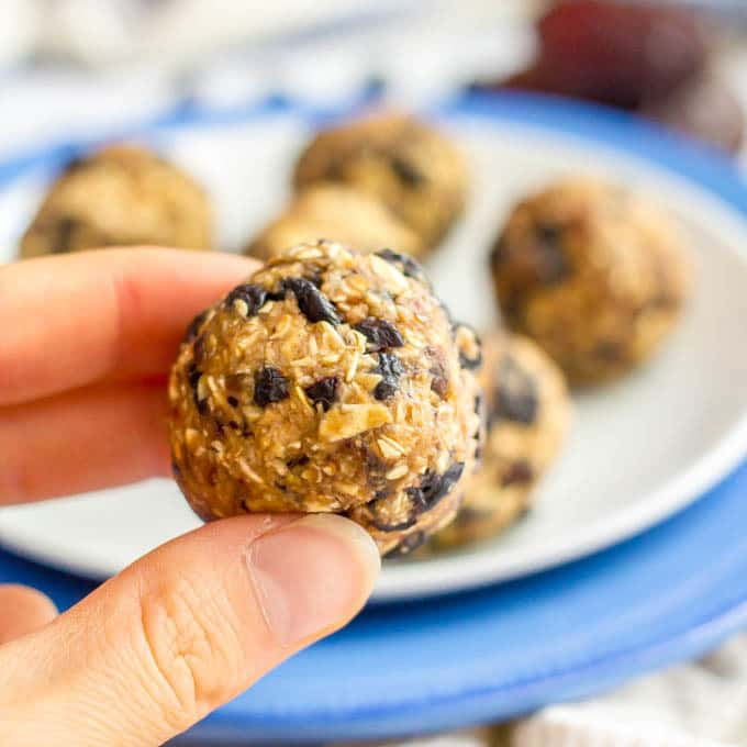 No bake blueberry oatmeal cookie ball held in hand