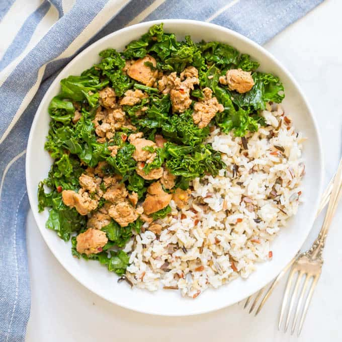 Bowl of wild rice with kale and turkey sausage