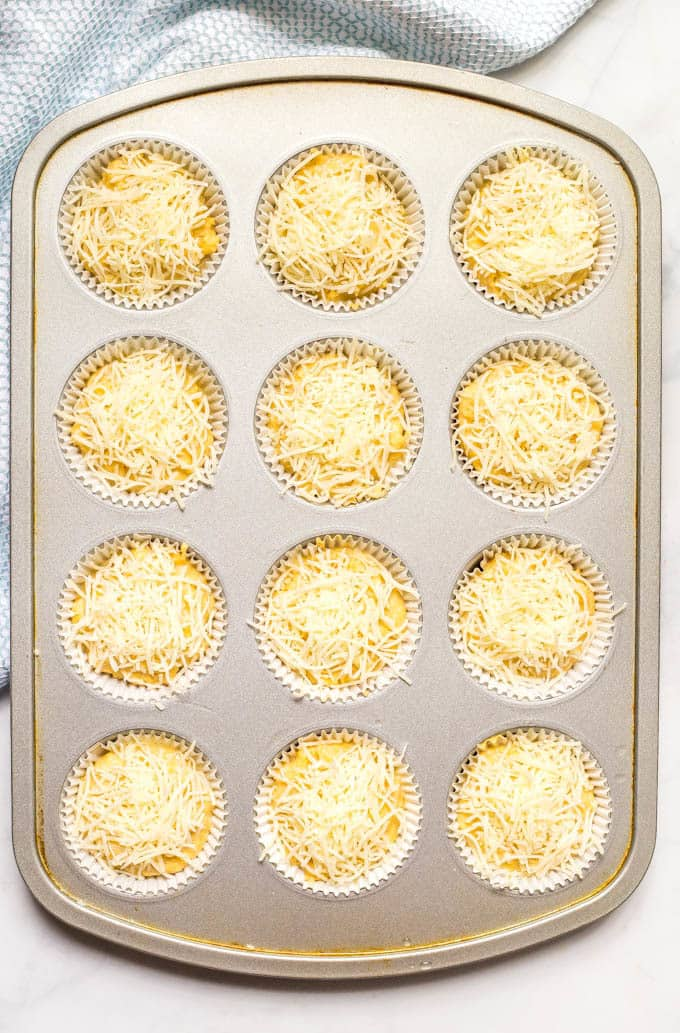 Overhead shot of easy cheesy cornbread muffins in muffin tin before baking