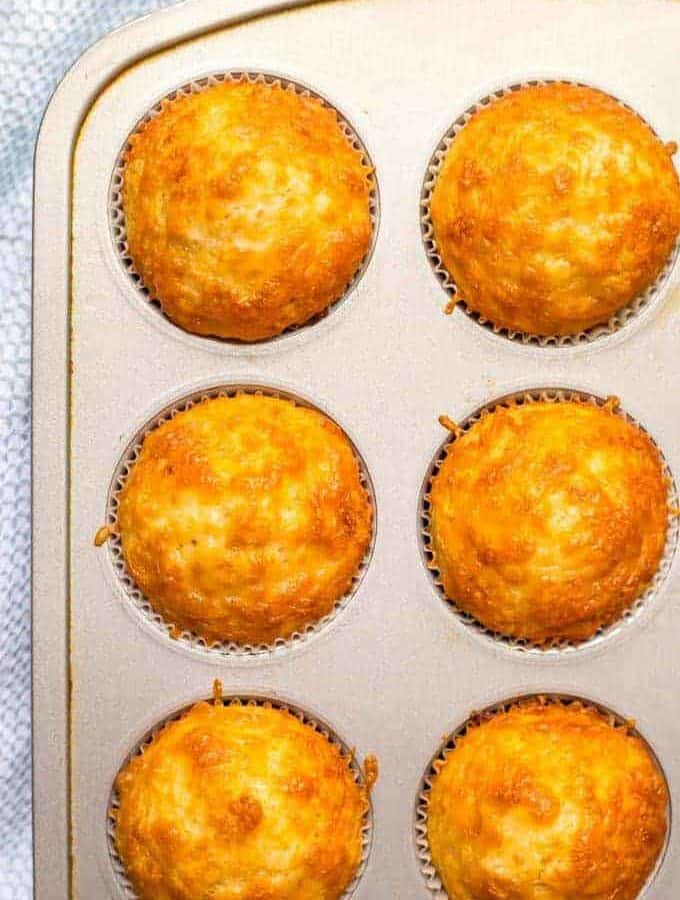 Easy cheesy cornbread muffins are whole wheat, naturally sweetened and made in just one bowl! They go great with soups and chili for a yummy dinner and can also be packed in a school lunch box! | www.familyfoodonthetable.com