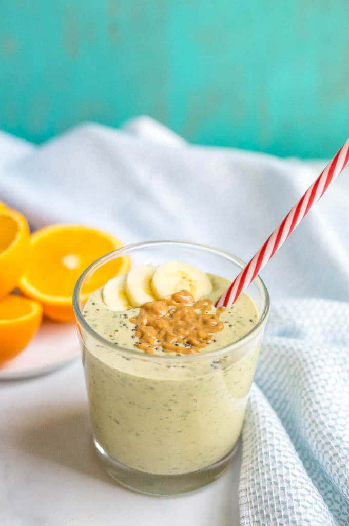 Peanut butter banana smoothie with spinach is a healthy breakfast or snack and full of wholesome ingredients! You can make it as a smoothie or smoothie bowl and dress it up with some fun toppings! | www.familyfoodonthetable.com