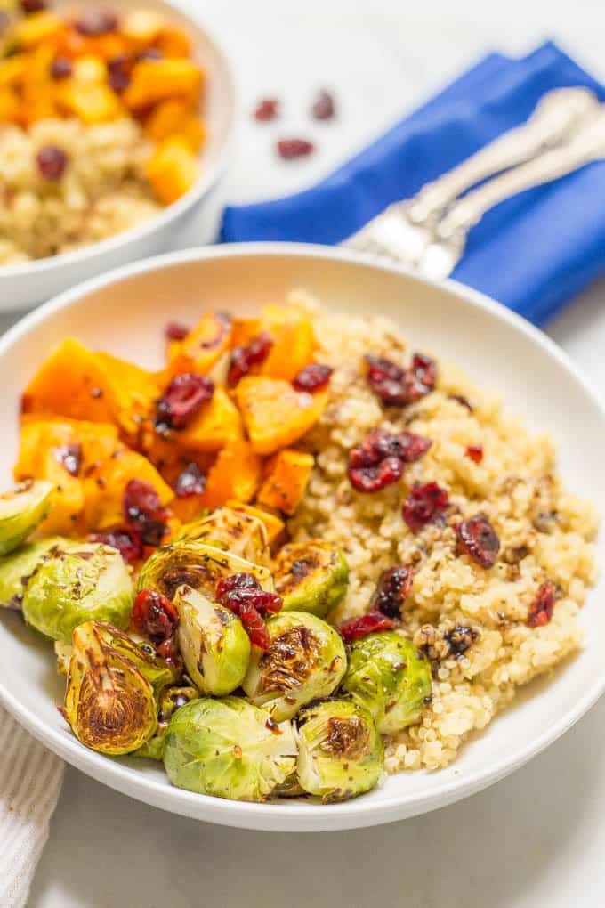 Quinoa bowl with butternut squash and Brussels sprouts close-up photo served in a bowl