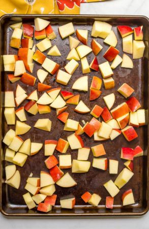 Cubed chunks of apple on roasting pan