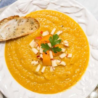 Roasted butternut squash apple soup is perfect for a cozy fall dinner! This soup is thick and filling and has a perfect background of sweetness and warm spices! | www.familyfoodonthetable.com