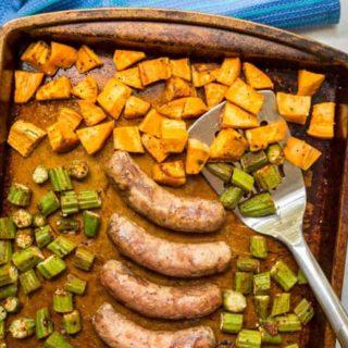 Sheet pan turkey sausages with sweet potatoes and okra on roasting pan