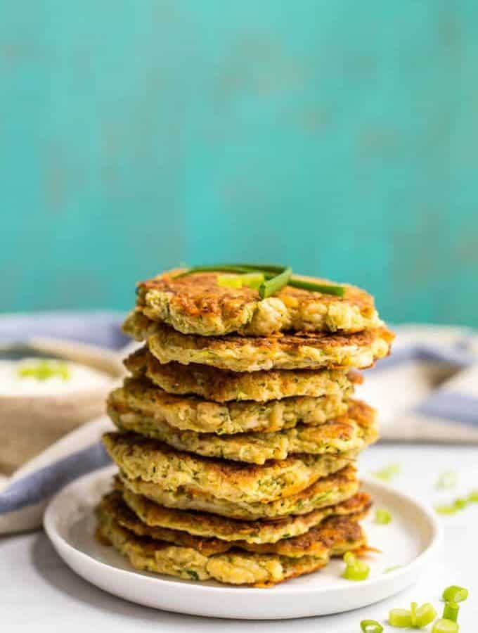 Whole wheat veggie pancakes with shredded squash and zucchini are an easy, fun way to get kids to eat their vegetables! They go great with Ranch dressing! | www.familyfoodonthetable.com