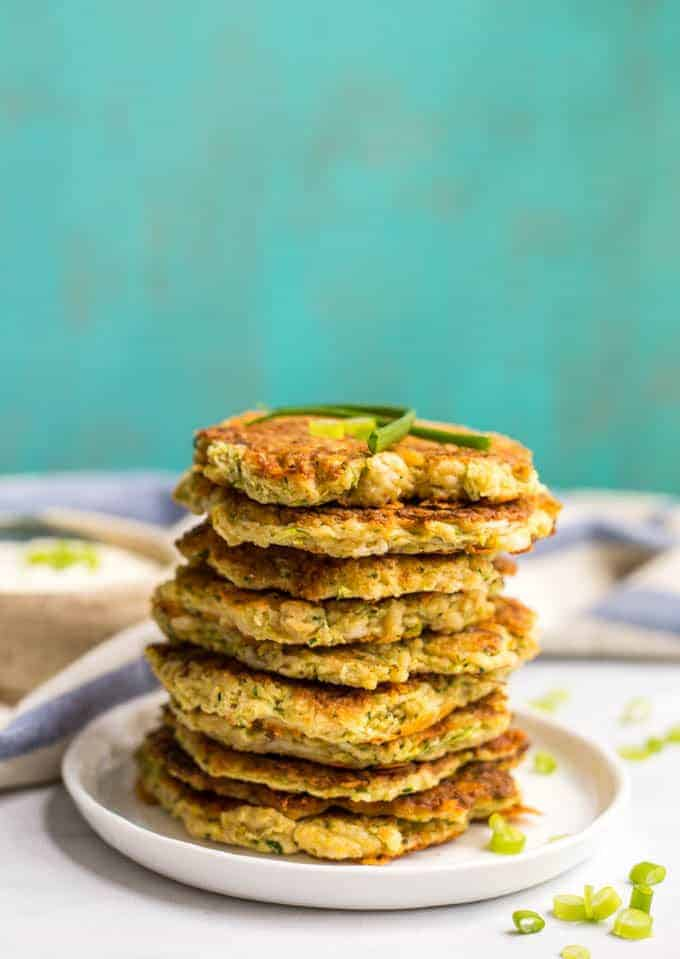 Whole wheat veggie pancakes with shredded squash and zucchini are an easy, fun way to get kids to eat their vegetables! They go great with Ranch dressing! #kidsfood #fingerfood #pancakes #healthyrecipe