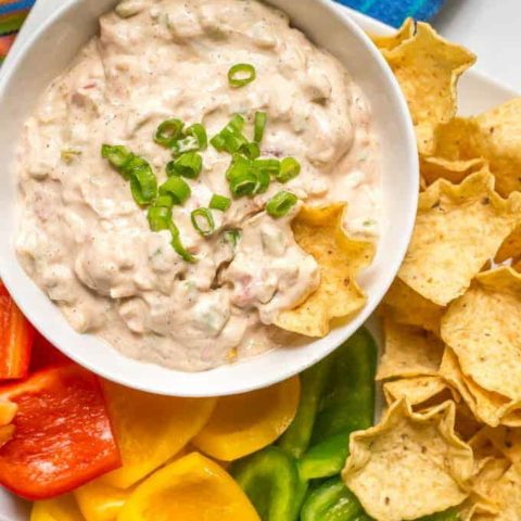 This cold chili cheese dip takes minutes to mix together and is delicious served with chips and veggies for an easy party or tailgating snack! It's also gluten-free and vegetarian. | www.familyfoodonthetable.com