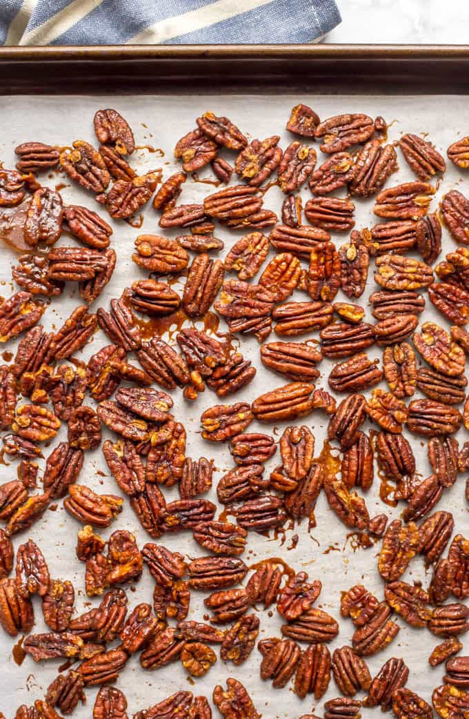 Sweet and spicy pecans with maple syrup are perfectly balanced with salty-sweet flavors and a little heat on the end. They're a holiday favorite! | www.familyfoodonthetable.com