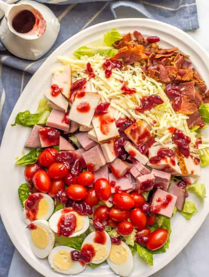 Thanksgiving leftovers chef salad is an easy, light no-cook lunch or dinner to make using leftover turkey, ham, deviled eggs and even cranberry sauce for the dressing! | www.familyfoodonthetable.com