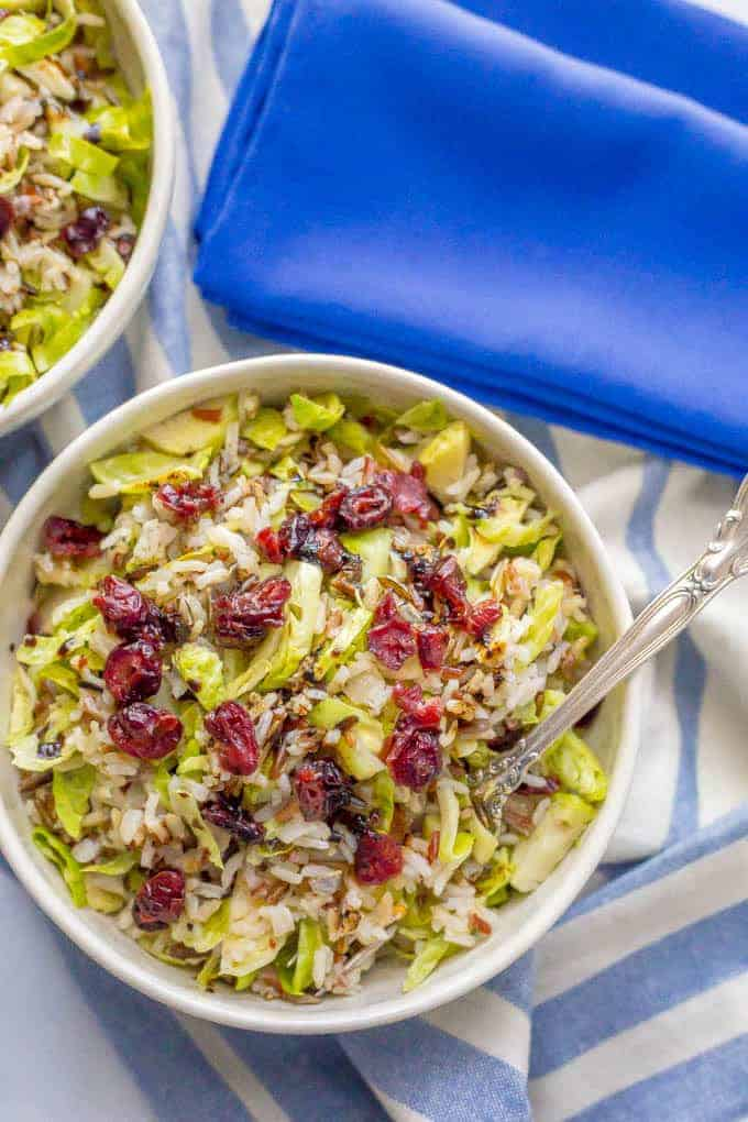 This one-pot wild rice and Brussels sprouts salad is a warm hug in a bowl! It's an easy side dish with just a few ingredients but has all the cozy fall feelings!   www.familyfoodonthetable.com