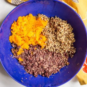 Butternut squash black bean quinoa burgers ingredients laid out in a blue bowl