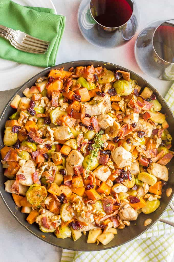 One-pot easy harvest chicken skillet with sweet potatoes and Brussels sprouts is a beautiful and delicious recipe that's perfect for a fall dinner! #onepot #chicken #easydinner | www.familyfoodonthetable