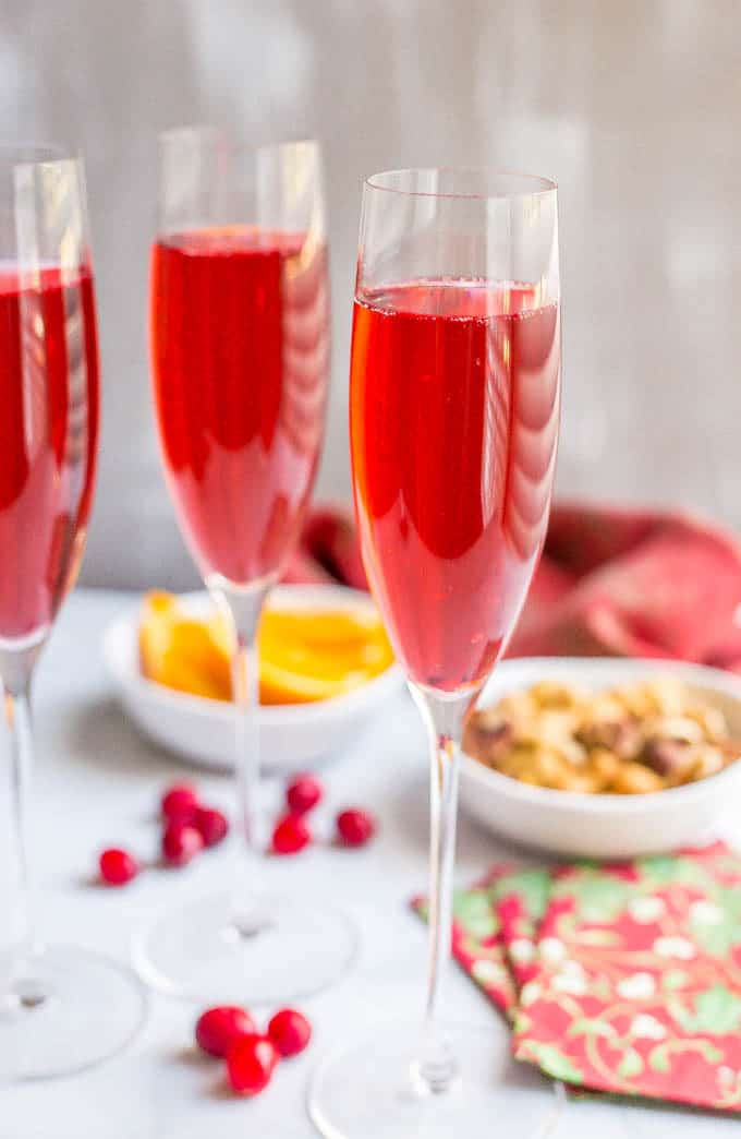 Poinsettia cocktail is an easy but pretty cranberry mimosa that's fun and festive for the holidays! #champagne #cranberryjuice #mimosa #cocktail #holidays | www.familyfoodonthetable