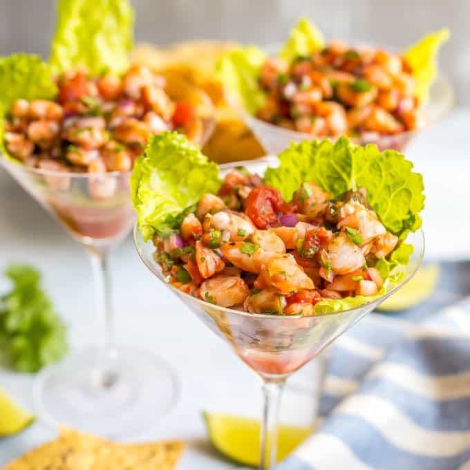 Easy shrimp martini salsa appetizer served up in glasses with lettuce underneath