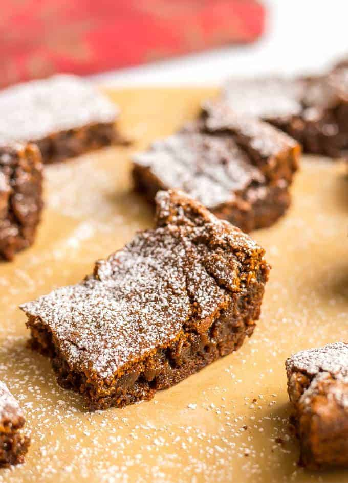 Whole wheat gingerbread cookie bars are soft and chewy and full of warm spices. They are perfect for holiday parties, bake sales and cookie exchanges! #holidaybaking #Christmas #gingerbread | www.familyfoodonthetable.com