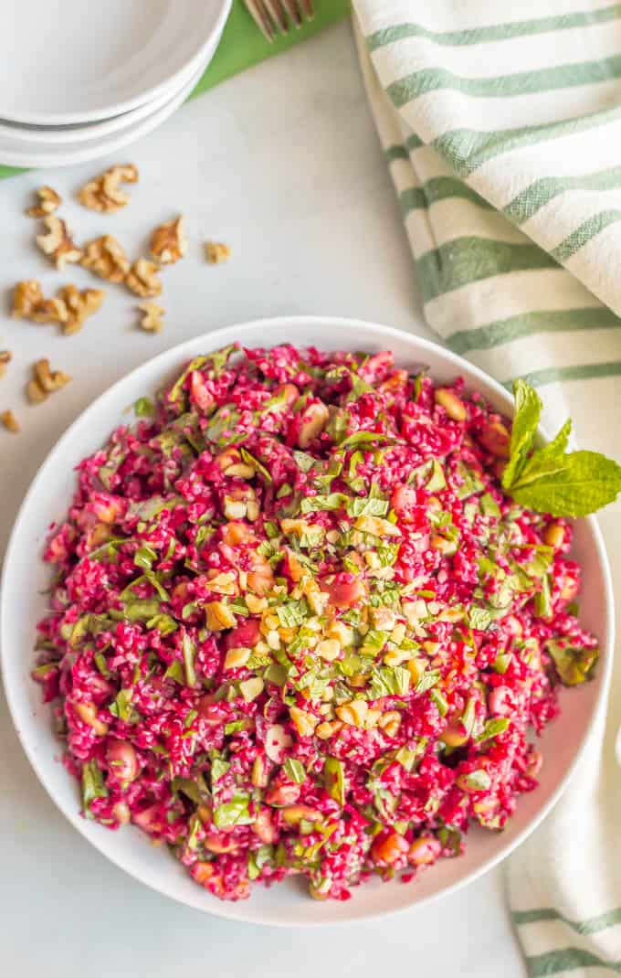 Spiralized beet quinoa salad with spinach, edamame, walnuts and an easy vinaigrette is a fresh, veggie-packed salad that's perfect for a healthy lunch or as a side for dinner. (V, GF) #spiralizer #quinoa #salad #vegan #glutenfree | www.familyfoodonthetable.com