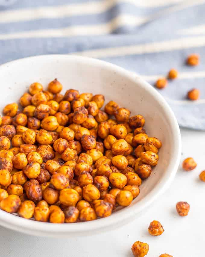 BBQ roasted chickpeas are crunchy, slightly spicy and totally addictive! They are great for a healthy, high-protein snack or to add some crunch to salads and wraps and dips. (Vegan, gluten-free) #chickpeas #healthysnack #vegan   www.familyfoodonthetable.com