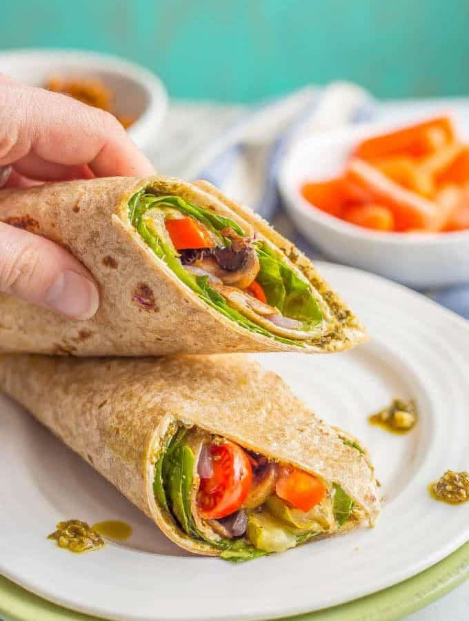 This roasted veggie wrap with pesto and goat cheese is the ultimate in lunchtime satisfaction! This vegetarian wrap can be prepped ahead and reheated and can also be customized to include your favorite vegetables! #veggiewrap #veggielunch #healthylunch | www.familyfoodonthetable.com