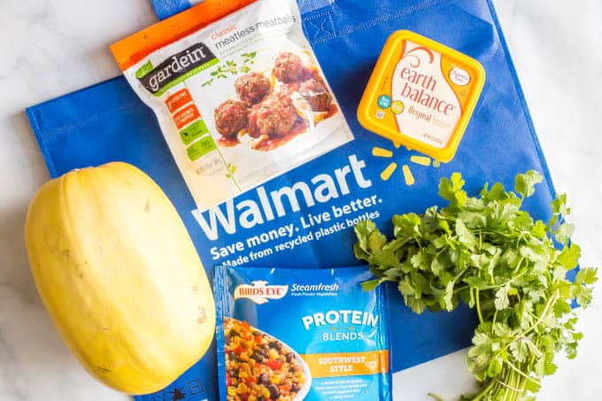 Ingredients to make southwest vegetarian stuffed spaghetti squash laid out on a blue Walmart bag