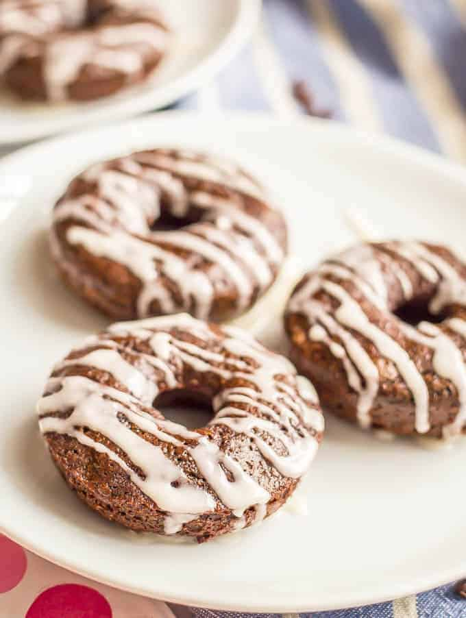 Whole wheat chocolate baked donuts have double the chocolate and none of the guilt! They come together quickly and make for a super fun healthy breakfast! Serve with an easy vanilla glaze, Nutella or a peanut butter frosting. #chocolatebreakfast #bakeddonuts #healthydonuts