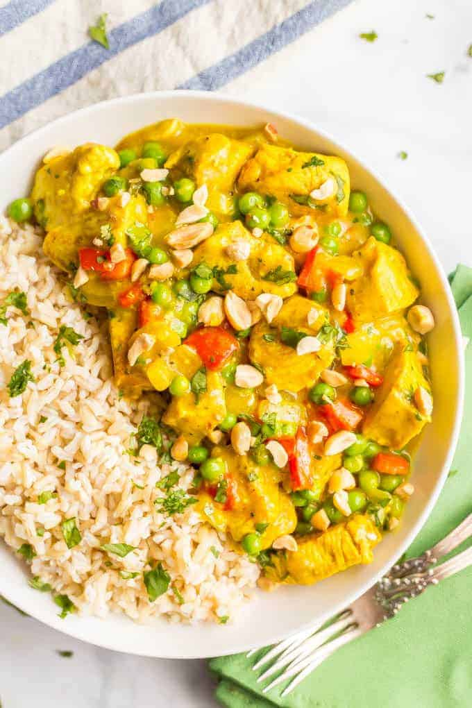 This quick and easy coconut chicken curry features colorful veggies and coconut milk for a creamy curry that's packed with flavor. Pair with brown rice or cauliflower rice for a fast weeknight dinner! #chickencurry #easychickenrecipe #quickchickenrecipe