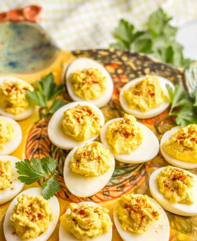 Close-up side angle shot of Mom's classic Southern deviled eggs on a traditional deviled eggs serving platter in the shape of a hen